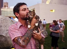 Lil Bub and her owner, Mike Bridavsky, are a threat to cuddle anywhere, anytime. | 60 Things I Learned At The 2013 Internet Cat Video Film Festival