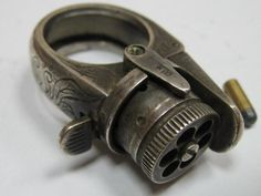 """Ring Gun: This 19th century French ring concealed a tiny gun capable of firing six 5mm bullets. Its name, quite appropriately, was """"Le Petite Protector."""""""