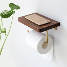 The modern Bentlee toilet paper roll holder shelf is the perfect accessory for your bathroom! Made from high quality black walnut wood/beech and brass. With a smooth and polished surface. Free Worldwide Shipping & Money-Back Guarantee Paper Roll Holders, Toilet Paper Roll Holder, Bathroom Toilet Paper Holders, Toilet Roll Holder With Shelf, Toilet Paper Storage, Toilet Paper Dispenser, Towel Holder Bathroom, Wooden Shelves, Wall Shelves