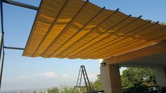 Madrid model retractable canopy pergola awning for sun protection - not for rain protection. Partially extended