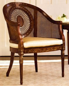 luxury Italian furniture | Regency style armchair with hand-painted floral design, hand-caned back, antique satinwood finish, cane seat and beige patterned cushion | armchairs