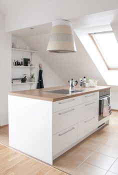 white modern kitchen island / decordots
