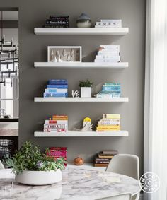 Chic and Modern in Chicago - Shelf arranging is the art of restraint – minimize for maximum impact.