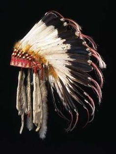"Description: Teton Sioux (Lakota) Headdress; Medium/Materials: Eagle feathers, felt, porcupine quills, red cloth, glass beads, yarn, ermine skins, horsehair; Marks: On ermine pendant, rectangular red cloth in black ink: ""D.D.11"""
