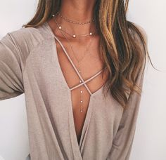 Loose top and necklaces.