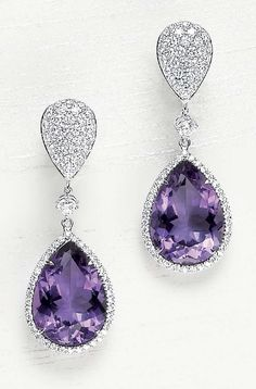 A Pair of Amethyst and Diamond Ear Pendants  designed as a pavé-set diamond drop, suspending a circular-cut diamond collet, terminating in a pear-shaped amethyst, within a pavé-set diamond surround, mounted in 18K white gold.