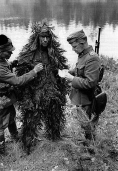 Finnish Army soldiers interrogating a captured Soviet sniper - Karelia, Finland, Aug 1941