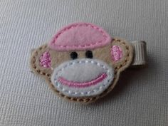 Embroidered pink sock monkey applique hair clip