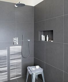 modern shower with dark grey tiles and niche - this looks so ...
