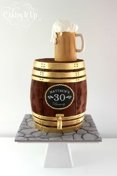 3D carved barrel 30th Birthday cake featuring fondant beer mug topper. www.facebook.com/cakingitup