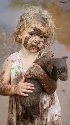 muddy lil girl carrying puppy