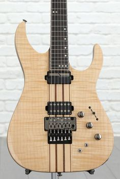 Solidbody Electric Guitar with Swamp Ash Body, Flame Maple Top, 7-pc Maple/Walnut Neck-through, Ebony Fingerboard, 1 Humbucking Pickup, and 1 Sustainiac System - Gloss Natural