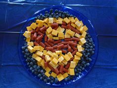 Superman food appetizer tray - cheese, pepperoni and blueberries