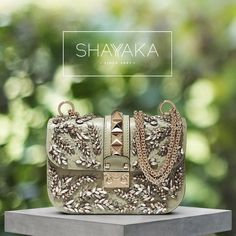 Valentino Lock Shoulder Bag Embellished with Swarovski Crystals | Gold Hardware | Small Size | 14 x 21 x 6 cm | Available Now  For purchase inquiries, please contact sales@shayyaka.com or +961 71 594 777 (SMS, WhatsApp, or iMessage) or Direct Message on Instagram (@Shayyaka). Guaranteed 100% Authentic | Worldwide Shipping | Bank Transfer or Credit Card