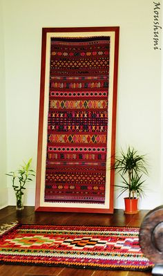 Hand woven tapestry from one of the islands of the Indonesian archipelago paired with a kilim from Turkey which also has an ikat weave