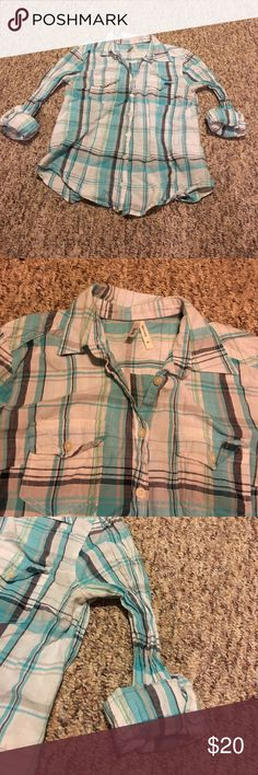 Light blue flannel shirt No flaws. The arms scrunch so that they can stretch if needed. Buttons up. I absolutely love this shirt I just wish it fit!!! Naked Truth Tops Button Down Shirts