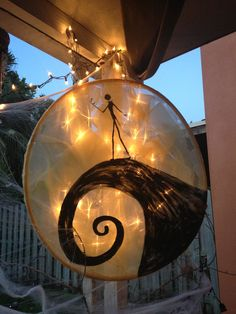 Jack's moon made with a hula hoop, sheer yellow fabric, and black paint for my twins' 7th Nightmare Before Christmas birthday party
