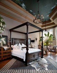 The night sky ceiling is eye-catching, but it's the other elements. The nightstand is not matchy-matchy with teh bed and love the small lam on it, as well as layered rugs and plant. British Tropical Bedroom Design Ideas, Pictures, Remodel, and Decor - page 2