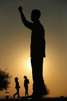 Children play next to a statue of Nelson Mandela which overlooks the city of Bloemfontein, the birthplace of the ANC