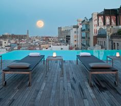 Barça rooftop / Grand Hotel Central. Grand Hotel Central is an attractive design hotel enjoying fantastic views of the Gothic Quarter and Barcelona Cathedral from its rooftop infinity pool. It offers stylish rooms with flat-screen satellite TV and hydromassage bath.    The air-conditioned rooms at the Grand Hotel Central have a modern design. They are equipped with Wi-Fi connection, as well as a DVD player, iPod docking station and sound system.