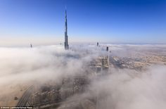 Shrouded: The Burj Khalifa is a 15-minute walk from the Index Tower, in the Dubai International Financial Center, from where Miss Luttecke took some of her pictures