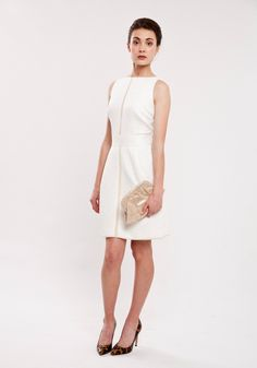 Exemplifying the chic French influences of the AW collection, the Natasha dress is cut in a whimsically feminine embossed floral with subtle touches of tonal white and vanilla colour blocking.  DRESS: http://www.fashionet.com.au/raoul/designer-dress-Natasha-Waisted-Dress  BAG: http://www.fashionet.com.au/lauren_merkin/lucy-champagne-clutch  SHOES: http://www.fashionet.com.au/lucy-choi/Goldstone-Gold-Leopard-Snake-lucy-choi-fashionet-australia