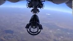 In this photo made from the footage taken from Russian Defense Ministry official web site on Monday, Oct. 5, 2015 a bomb is released from Russian Su-24M jet fighter  in Syria. NATO strongly criticized the Russian air campaign in Syria that began Wednesday. (Russian Defense Ministry Press Service via AP)