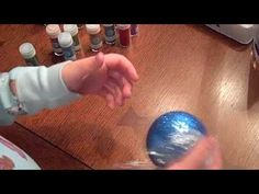Glitter Ornaments video tutorial  - secret ingredient is floor wax!  Quick and easy project!