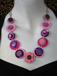 BUTTON JEWELRY  button necklace shade of pink & purple with silver chain.     buy  necklace and get earring in the same colours  for FREE. $38.00, via Etsy.
