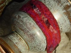 Bracelet: red and pink nuno felted silk and by DunroaminFarmDesign