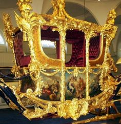 The Golden State Carriage from the Royal Mews in London used for the coronation of Queen Elizabeth II - 1st of 2 photos - closeup of LH side.