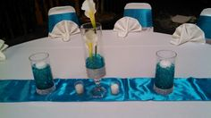 Floating candles,calla lillies and water beads!! Pretty and cheap centerpice!!