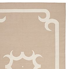 Mocha colored rugs with baby blue walls and white nursery furniture
