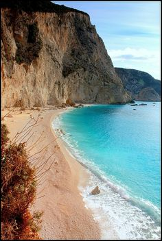 The amazing Porto Katsiki beach on the Island of Lefkada, Greece. Lefkada, is a Greek island in the Ionian Sea on the west coast of Greece, connected to the mainland by a long causeway and floating bridge. Places Around The World, The Places Youll Go, Places To See, Around The Worlds, Beautiful Islands, Beautiful Beaches, Beautiful World, Dream Vacations, Vacation Spots