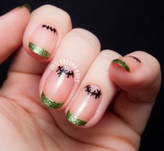 Simple and cute Halloween nail art.  Have classy green glitter French tips while drawing bold stitch line on your cuticles.
