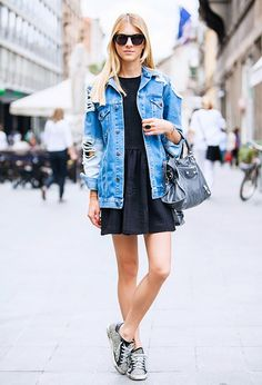 Pair a distressed denim jacket with a comfortable black dress and sneakers for the perfect daytime look.