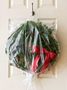 Treat wreaths with the same care you give your favorite party dress. Slip the hoop over the neck of a coat hanger, then cover with a plastic dry cleaning bag to prevent a year's worth of dust from building up. Hang in a closet or from a beam in your attic.