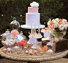 dessert table, with flowers, candels, glassware..