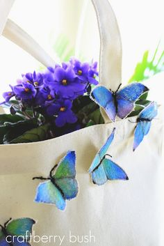 Butterfly Tote...a very sweet tutorial beginning with how to make the canvas butterflies.