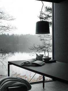 Minimalist Interior Space in Vipp Shelter Overlooking Lake