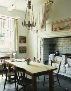 For some reason the stove in the fireplace makes me smile. [ hearth & home; the kitchen is the heart of the home. love the big white aga but I might have to stick with the little one ]