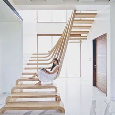 Floating stair brilliance. Love the timber texture contrast against the white floors & walls.