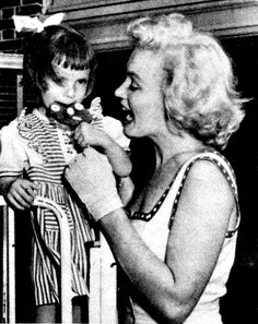""""""" Marilyn at a children's orphanage in 1952. """""""