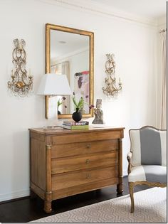 Living Room by Ashley Goforth Design. Love the antique chest with the crystal lamp. Cool mix of the old with the new.