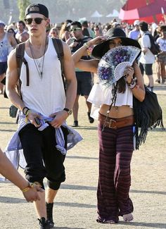 7d5d0ccbc9e California cool  Vanessa Hudgens took a creative approach to hiding from  the sun as she and her toyboy Austin Butler enjoyed some music at the  Coachella ...