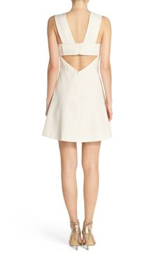 Free shipping and returns on FELICITY & COCO Back Cutout Fit & Flare Dress (Regular & Petite)(Nordstrom Exclusive) at Nordstrom.com. A deep, tasteful V-neckline fronts a classic black cocktail dress finished with a crisp bow in back above a flirty cutout.