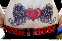 Winged heart as a lower back tattoo