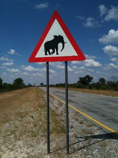 Elephant Crossing - Caprivi Strip, Namibia. I wanted to steal this sign so badly!