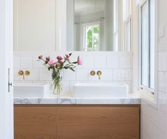 Two bathrooms compliment and contrast in this Auckland villa