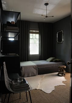A Grey palette unifies this Masculine Mens Bedroom.
